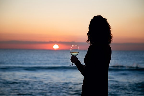 Enjoy a glass of wine and the amazing sunset show at Foster Memorial
